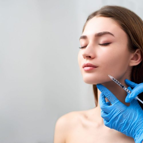 Smile Lifting And Lip Augmentation. Beautician Doctor Hands Doin
