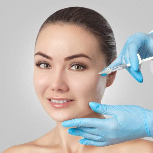 The Doctor Cosmetologist Makes The Rejuvenating Injections Proce